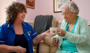 Elderly with a carer