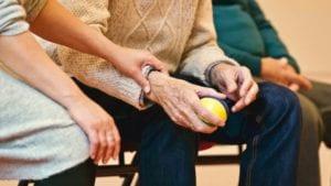 Elderly man with ball